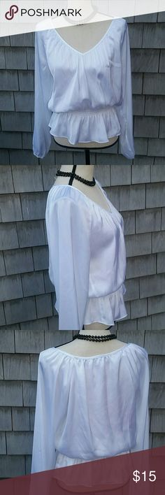 Michael Kors blouse Beautiful perfect condition white silky blouse. Semi sheer and very attractive on. Great for date night.no rips or stains. 100 % polyester for easy care. Slight shine to fabric Michael Kors  Tops Blouses
