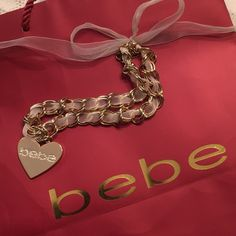 """Bebe✨Gold Heart Rhinestone Necklace Gold tone cream ribbon Bebe necklace with bag. Approx 10"""" long. In nice condition. See pics for condition. bebe Jewelry Necklaces"""
