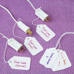 Holiday lights are a festive addition to any home, but remembering which cord matches each strand is a challenge for even the most organized homeowners. Simple handwritten tags secured around the base of each cord lead you to the right light every time. Christmas String Lights, Holiday Lights, Cord Organization, Cord Storage, Printable Labels, Gadgets And Gizmos, Getting Organized, Storage Solutions, Helpful Hints