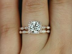 This engagement ring is designed for those who love simple with a slight twist. The round cut in the center is traditional while the cushion halo repin & like. Check out Noelito Flow music. Noel. Thanks https://www.twitter.com/noelitoflow https://www.youtube.com/user/Noelitoflow