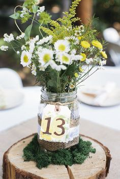 Vase 'tags' for table numbers. . . Robyn this would definitely be the easiest way to include the table numbers on your centerpieces.