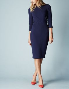 You'll love this figure-hugging below-the-knee dress as much as it loves your body. The season's sexiest shape?