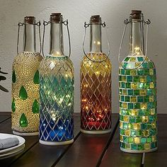 Best DIY Ideas and Designs of Wine Bottle Craft - Live Enhanced bottle crafts lights Wine Bottle Craft Ideas Old Liquor Bottles, Liquor Bottle Crafts, Wine Bottle Art, Lighted Wine Bottles, Diy Bottle, Wine Bottle Lanterns, Bottle Lights, Beer Bottle, Diy Projects With Wine Bottles
