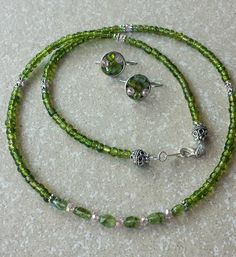 - Jewelry creation by K. Diy Jewelry, Jewelry Sets, Beaded Jewelry, Handmade Jewelry, Jewelry Making, Crystal Necklace, Beaded Necklace, Peridot, Earring Set