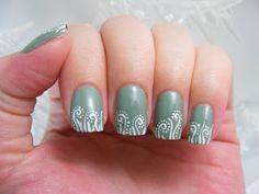 White swirls on OPI Thanks a Windmillion nail art design