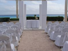 An Oceanview Wedding Venue or Commitment Ceremony in White. Then dress up with your colors using ribbons, scarves, lace, flowers, glass and flags! by www.DestinationWeddings.travel - recognized Wedding Planner: PJ