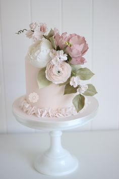 Delicate single tiered sugar floral blossom wedding cake by Poppy Pickering in Pretty blush and ivory tones