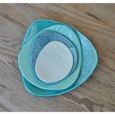 Set of 4 Turquoise Blue Pottery Dishes, Doily stamped Handmade Side... ($39) ❤ liked on Polyvore featuring home, kitchen & dining, serveware, handmade pottery platters, pottery platters, ceramic appetizer plates, handmade ceramic platters and handmade ceramic dishes