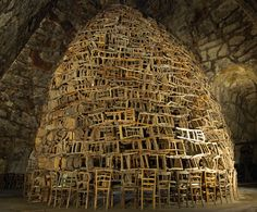 tadashi kawamata temporary installation, a church with a babel tower of chairs