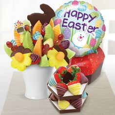 Featuring an assortment of colorful and tasty fresh fruit favorites packaged into one truly WOW-worthy treat, our Egg-Cellent Easter Gift Set is just what you need to celebrate Easter! Perfect for gifting and entertaining, this incredible gift set includes an arrangement crafted from some of our favorites like chocolate dipped pineapple daisies and a pineapple bunny, grapes, and chocolate covered strawberries decorated with colorful Swizzle®!