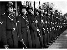 Waffen-SS  072. ( original caption). Waffen SS in dress uniform. Date and location unknown.