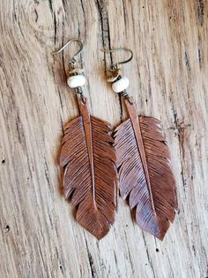 Handmade leather feather earrings with natural color stone beads & chips. The backs of the earrings are painted dark brown. from hook to bottom of feather & 1 inch wide. Fish Hook Earrings, Feather Earrings, Etsy Earrings, Leather Jewelry, Leather Craft, Leather Tooling, Tooled Leather, Earring Crafts, Diy Jewelry