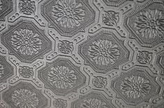 paintable wallpaper on the ceiling to look like tin ceiling