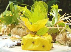 Tropical-inspired gift/favor wrapping - using yellow tissue, apple green  sinamay,