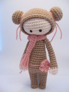 Handmade amigurumi doll . I haven't found a pattern for this cutie but I think it could be duplicated without one. The maker of the doll has published a book (in Swedish) that contains this doll but it has not been translated into English or other languages yet.