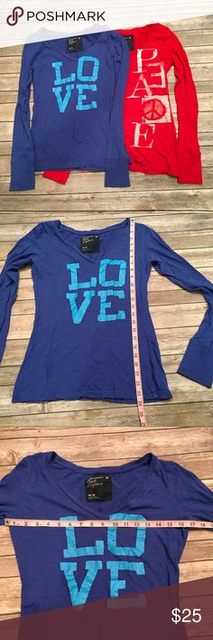 American Eagle Long Sleeve Medium Top Bundle LOVE & PEACE long sleeve tops in blue and red. Have been loved but still a lot of wear in them. See photos for condition. No stains or holes. Just some cracks in the lettering.     📦Fast Shipping 💌Packaged with care   ⭐️20% of earnings are donated to the A21 campaign that works toward ending human trafficking in the 21st century⭐️  ❣️27 MILLION slaves worldwide- Most in history! 💔1-2% of victims are ever rescued ❣️The average age of a…