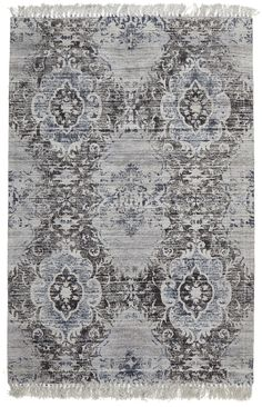 La Plata is a stunning fringed flatweave rug featuring a vintage look damask floral design. Made in India from a silky soft blend of viscose (70%) and cotton (30%), this bohemian statement piece is about 10mm thick. La Plata primarily features grey