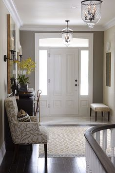 Sarah Richardson - tile at the door for easy care, then hard woods, gray accent wall, taupe main walls