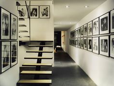 "A Four Story Modern Home Iconic ""Urban Retreat"" in New York City by Paul Rudolph: Paul Rudolph 101 East 63rd Street: Interior black and white hallway with wall photos"