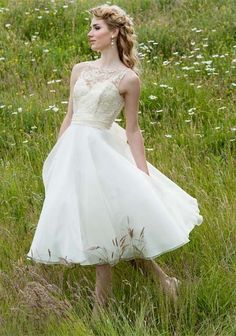 elegant simple A line lace and organza Tea-length wedding dress with straps. $162.00, via Etsy.
