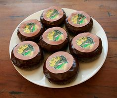 Chocolate Donuts with edible cake toppers - looks like hockey pucks! I may have to use ding dongs though!
