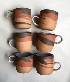 Three clay mugs for a shop update next week! My personal favorite mug at home, and the combo of clays that best executes the marbling pattern I'm searching for