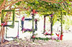 Funky Hawaiian inspired wedding reception decor using floral frames as space dividers.