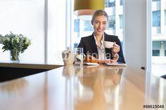 """Pobierz zdjęcie royalty free  """"Business woman having breakfast"""" autorstwa dglimages w najniższej cenie na Fotolia.com. Przeglądaj naszą bazę tanich obrazów online i odnajdź doskonałe zdjęcie stockowe do Twoich projektów reklamowych!"""