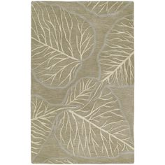 This handsome Graffix rug is hand-tufted using only the finest, 100-percent virgin wool and features a beautiful transitional design. The attractive home accent presents fashionable colors to meet all your decorating needs and is hand crafted in India.