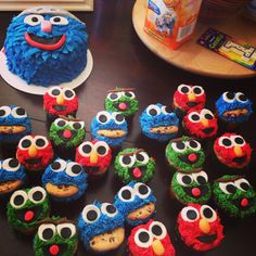1st Birthday Sesame Street cupcakes and Super Grover Smash Cake.  Made by Sweet Tammy Cakes!