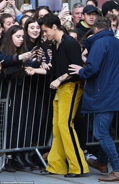 Not-so-mellow yellow! Harry Styles continues to showcase his offbeat wardrobe at The One Show in banana-coloured flares... after wearing a 'laundry bag suit' earlier in the day