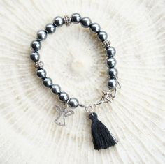 Tassel angel charm  bracelet, Silver accented beads, Gray bracelet, Charm bracelet