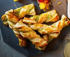 Twisty cheese straws: Puff pastry is ideal for canapés. Try twisted with cream cheese and pesto then baked until crispy christmas appetisers Bbc Good Food Recipes, Cooking Recipes, Yummy Food, Birthday Appetizers, Party Appetizers, Pesto, Christmas Buffet, Christmas Eve, Christmas Cooking