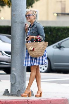 Reese Witherspoon wearing Kayu St. Tropez Tote, Draper James Parton Check Mary Beth Halter Dress in Blue Parton Check and Draper James Stella Sunglasses in Bluebell