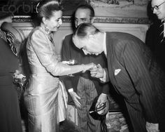 Carl Jacob Burckhardt, the Swiss envoy in Paris welcomes Eva Peron, also known as Evita, wife of Argentinian president Juan Peron, pictured in July 1947 in Paris, France.