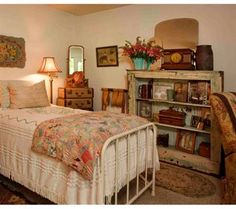 Inspiration Gallery, Reader Photo Showcase, ← Back to Home Tours 2011, Flower Power Cottage-inspired hues color the bed, bookshelf and walls in one of Wendy and Gary Rushing's bedrooms. Uploaded on 09/22/11Photographed by Philip Clayton-Thompson. Styled by Donna Pizzi beginning of album