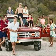 Coolest Family Picture ever, laid back, surfer style on the beach. Love the old car and the way the family is all over, and the swim suits and casual clothes. It just looks rad.