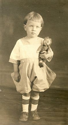 Boy & mask face Googly, c 1920 by fluffy chetworth, via Flickr