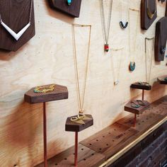 James Worsham. Dowels in varying heights with interchangeable walnut platforms fit into pre-drilled bases.
