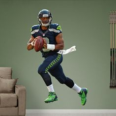 Russell Wilson wall decal | 12 Ways to Decorate a Seahawks Fan Cave | Seattle Met