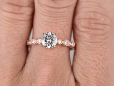 Moissanite Engagement ring,14K&18K Rose/Yellow/White Gold Available. Every Jewelry in my store needs making to order. If you have the stone,you can ask us custom making the ring setting!  [Item details]  Engagement Ring: Solid 14K Rose Gold(Can be made in white/yellow/rose gold)  Band Width approx 2.2mm  Size 5#(Ring can be resized)  5mm Round cut 0.5ctw Charles & Colvard Moissanite  0.13ctw Round Cut SI-H Natural Conflict free diamonds  Prong,Bezel Set  Estimated ...