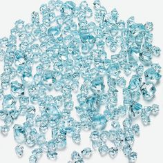 "Blue Ice. Make any centerpiece shine with these bits of faux blue ""ice"". Sprinkle this magical acrylic ice on your wedding reception tables. (Approx. 225 pcs. per unit) 3/8"" - 1"""