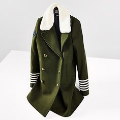 Tommy Hilfiger women's coat. This peacoat is part of an exclusive capsule collection designed by Gigi Hadid and Tommy Hilfiger. This updated classic features a double-breasted design with branded buttons in a stunning slim fit. Contrast cuff stripes and faux shearling collar complete the look.<br>• Slim fit.<br>• 70% wool, 25% synthetic, 5% polyamid.<br>• Button closure, lined, slash pockets. <br>• Dry clean. <br>• Imported.<br>