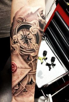 Compass and Letter half sleeve tattoo
