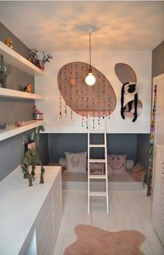 Beautiful bunk bed idea and sitting area underneath for a kid's room