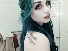 #turquoise #bright #colorful #hair #green #eyebrows #elf #ears #extentions #tolkien #graphic #tattoo #huge #eyes #makeup #piercing #madonna #pale