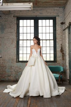 Brett | Strapless deep V silk gazar ball gown with dramatically draped and bowed skirt
