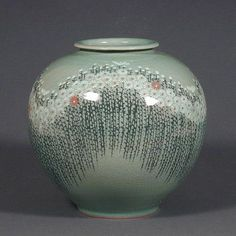 What Is Celadon Pottery | This beautiful celadon jar is decorated with a field of chrysanthemums ...