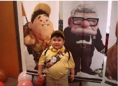 This kid looks just like that kid in Disney Pixar's Up.  Too funny.