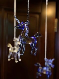 I want a mobile like this but of Glass Swans.....Once Upon A Time Snow White Glass Unicorn Crib Mobile (blue)